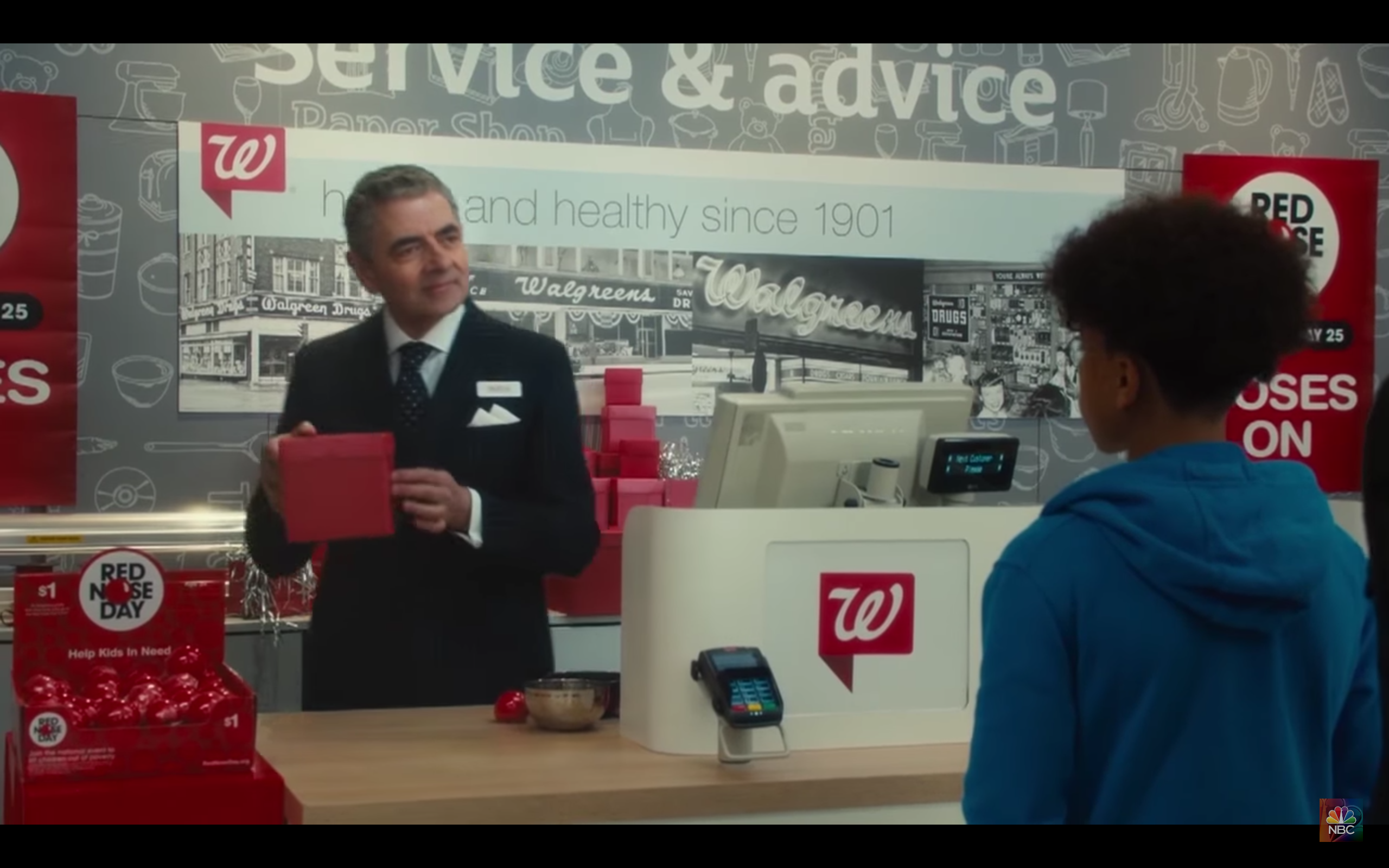 rowan atkinson walgreens red nose day.png